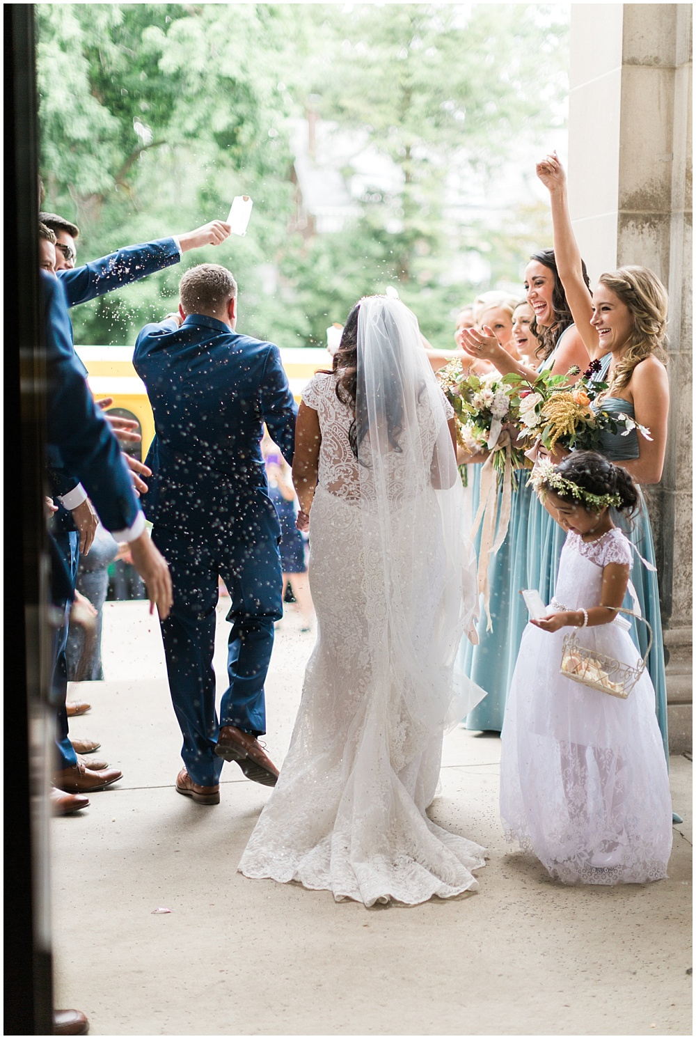 bride and groom ceremony exit; birdseed formal exit; tossing birdseed; white lace wedding dress; Mexican inspired gold & floral wedding; Crowne Plaza Indianapolis Downtown Union Station; neutral floral and greenery wedding|Cory + Jackie and Jessica Dum Wedding Coordination