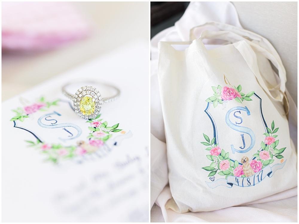 6 ways to elevate your wedding details; custom monogram crest; custom invitation suite; custom bridesmaid bags; custom guest welcome bags; blue and pink monogram; yellow diamond ring