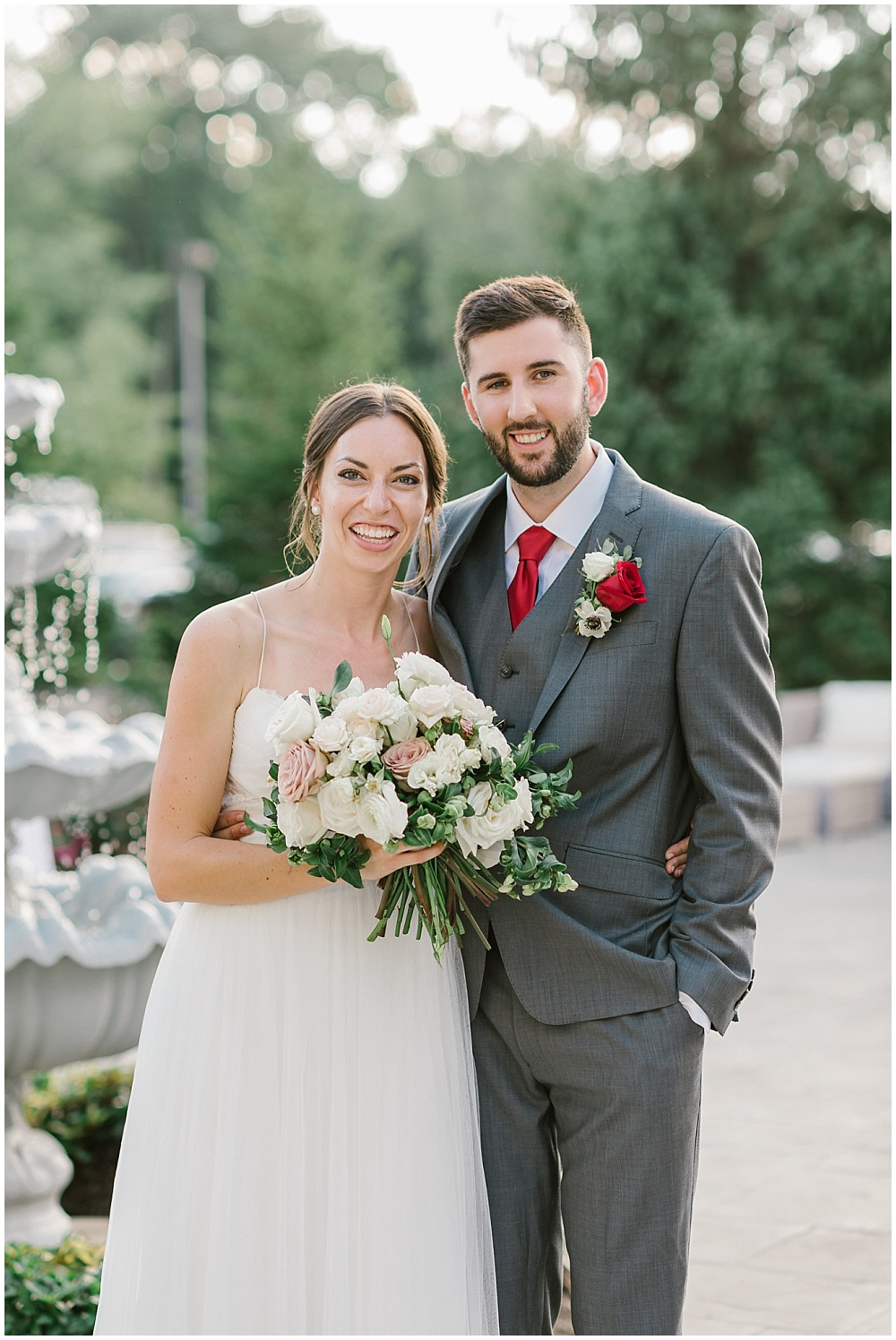 Bride and groom garden portraits with a bridal bouquet made up of white and soft blush blooms Fall garden-inspired wedding at the Ritz Charles Garden Pavilion in Carmel, Indiana | Jessica Dum Wedding Coordination