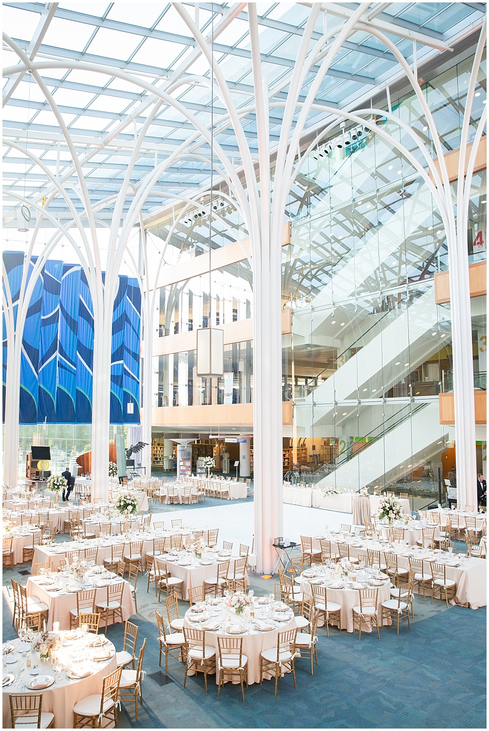 Central Library's gorgeous ballroom space with blush and gold wedding tablescapes.   Spring blush and gold downtown Indianapolis Central Library wedding alongside Evangeline Renee Photography + Jessica Dum Wedding Coordination