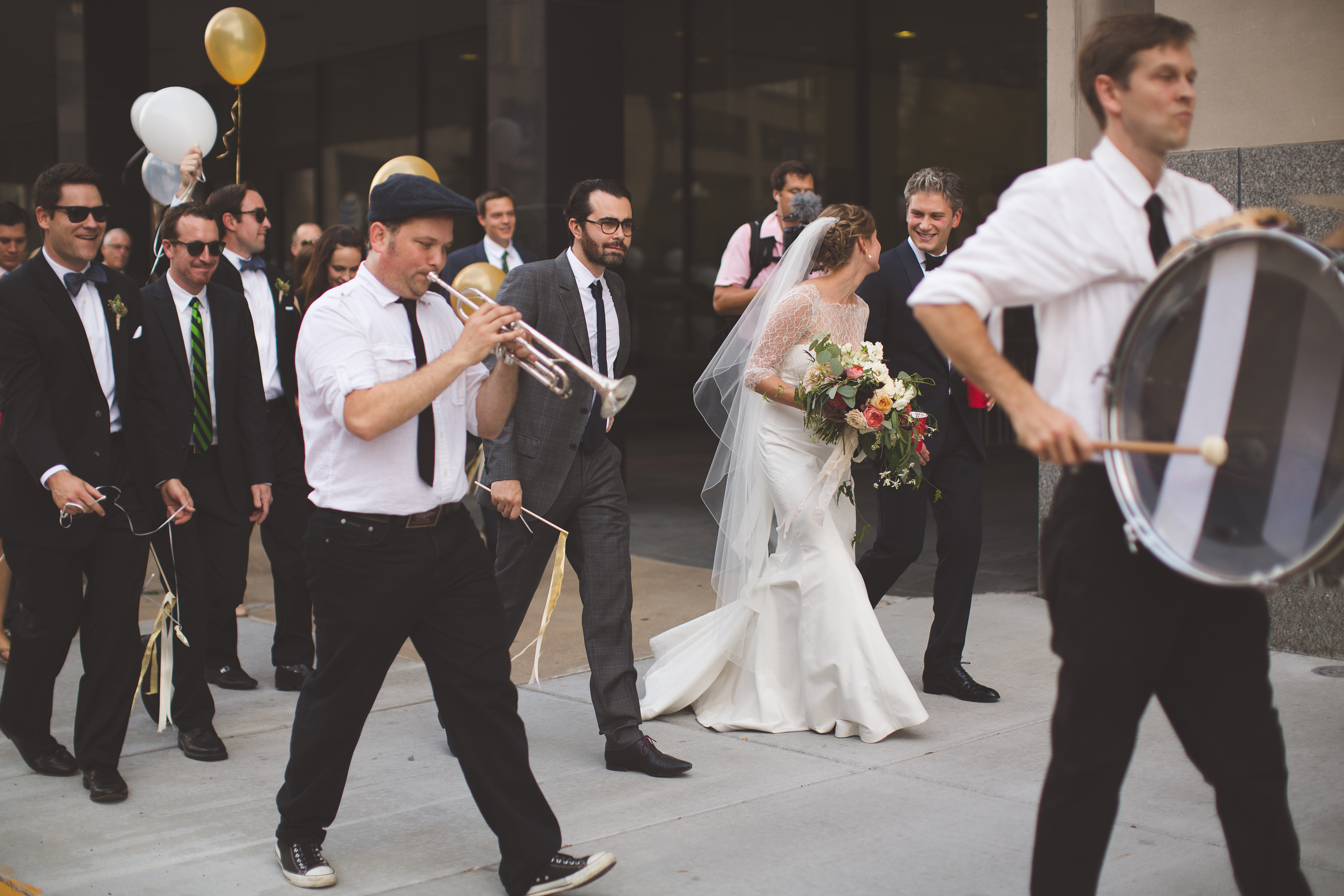 Looking to do a formal exit from your ceremony or reception? We're sharing 12 fun sendoff ideas for exiting your wedding in style over on the Jessica Dum Wedding Coordination blog today! | New Orleans style wedding parade complete with a brass band, balloons and ribbon wands!