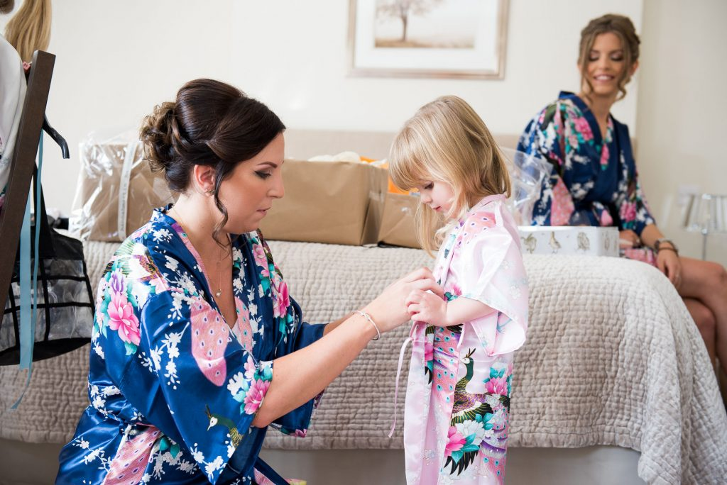 Bridesmaid with flower girl wearing floral robes pre wedding photography