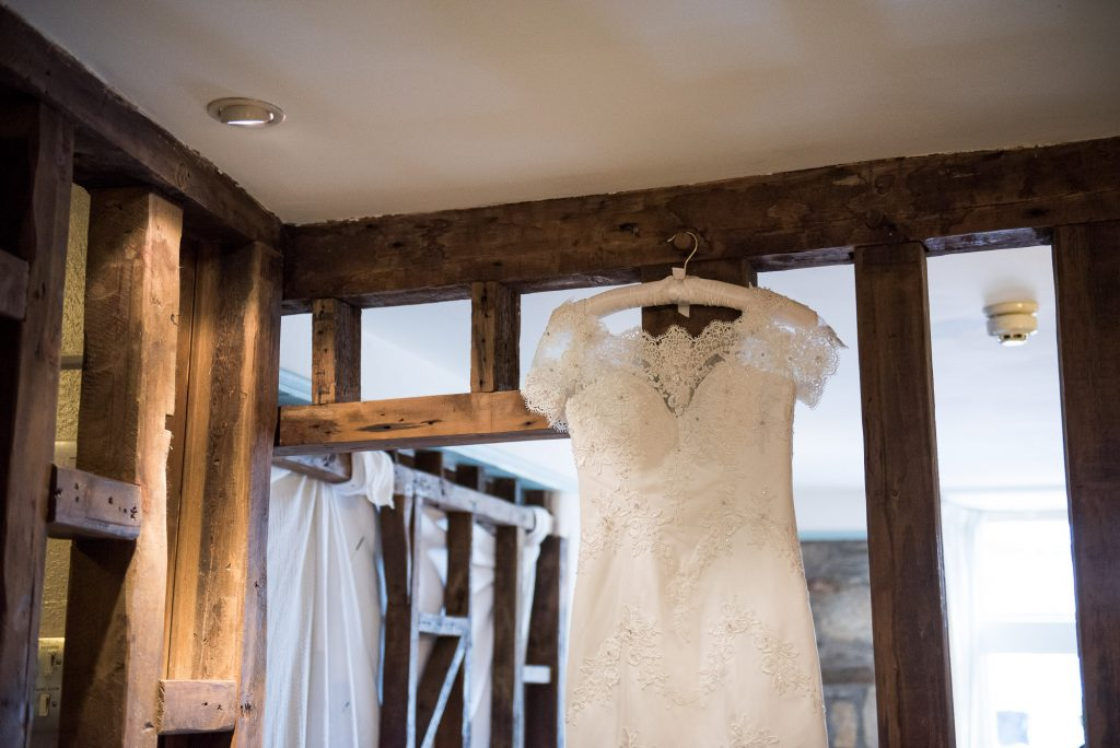 Hanging bridal dress from Wedding Dress Retail Outlet Cornwall beach wedding