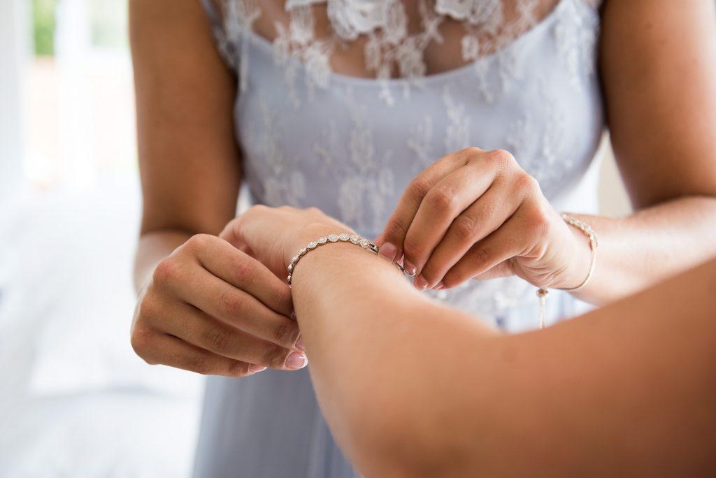 Coast bridesmaids with matching bracelets