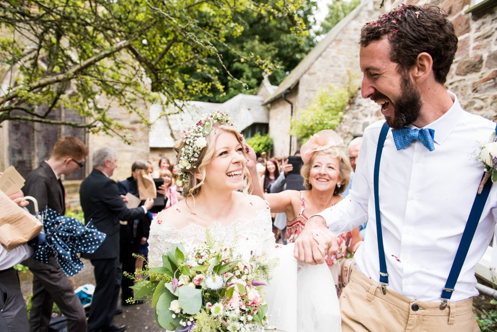 Happy bride with groom rustic Cornwall beach wedding