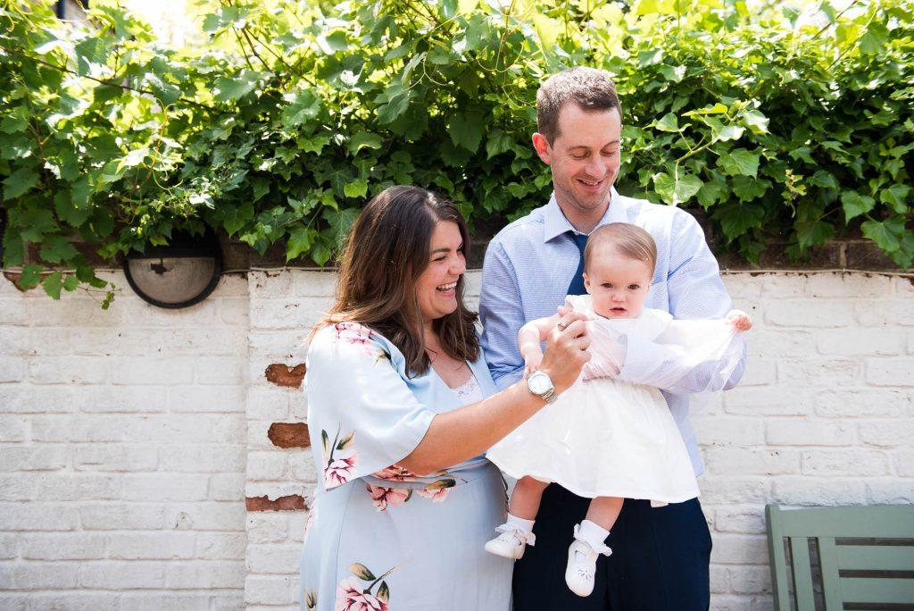 Happy family christening photography Surrey