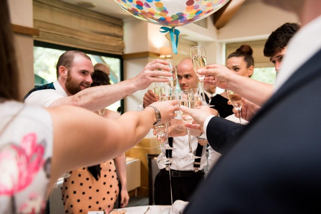 Champagne wedding toast Wilde Theatre wedding