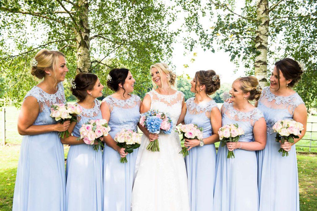 Bride with bridesmaids summer countryside wedding