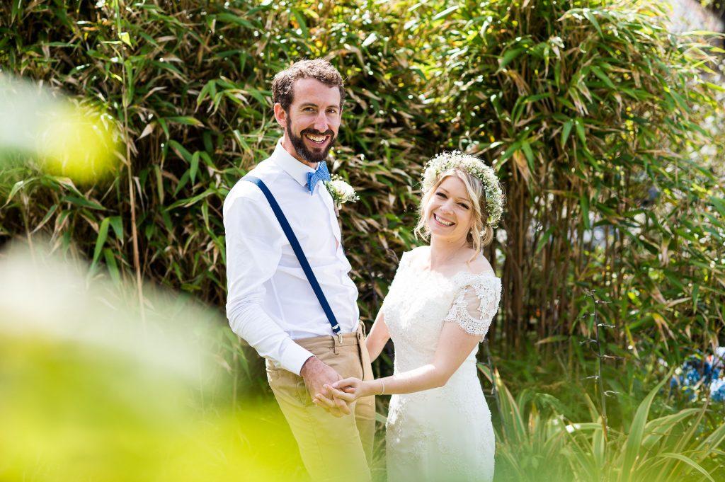 Happy bride with groom Cornwall boho beach wedding