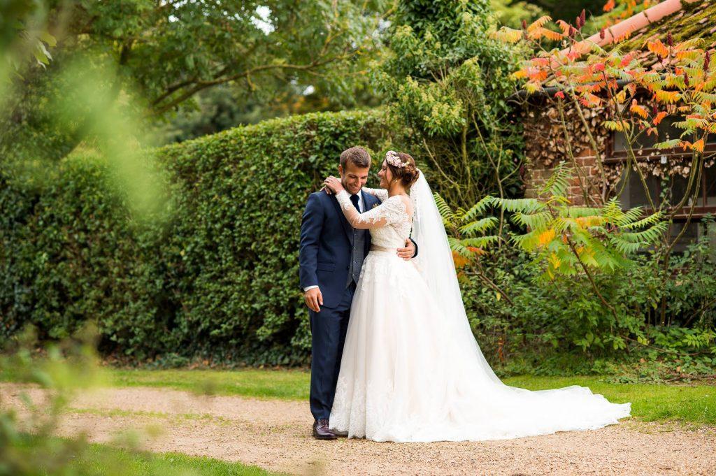Natural wedding portrait with bride wearing Jay West Bridal groom wearing Calvin Klein Norfolk Barn Wedding