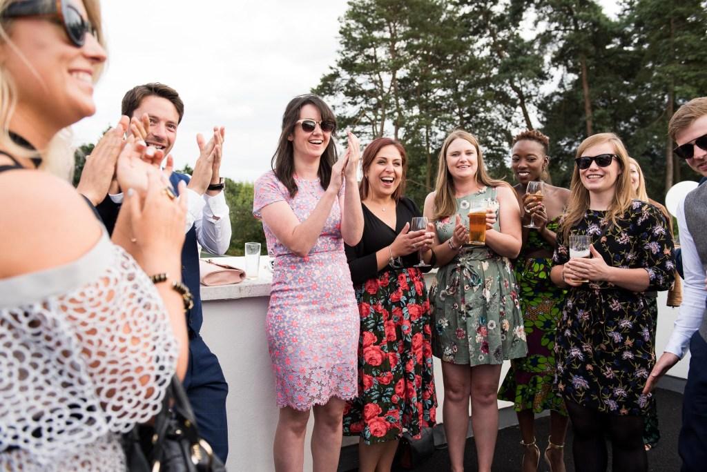 Wedding guests laugh Wilde Theatre Berkshire