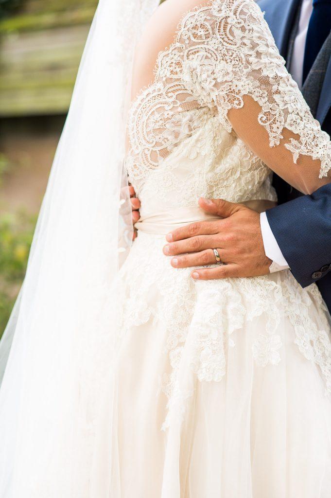 Bride wearing Jay West Bridal gown groom wearing Calvin Klein Norfolk