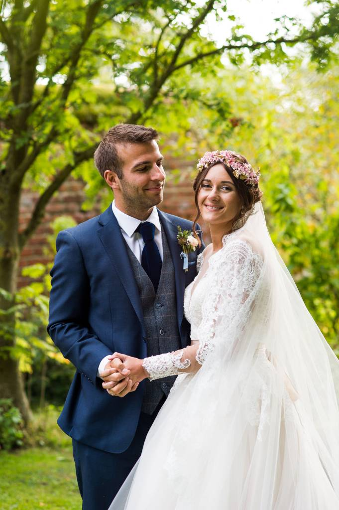 Natural wedding portrait bride wearing Jay West Bridal dress Spixworth Hall Wedding