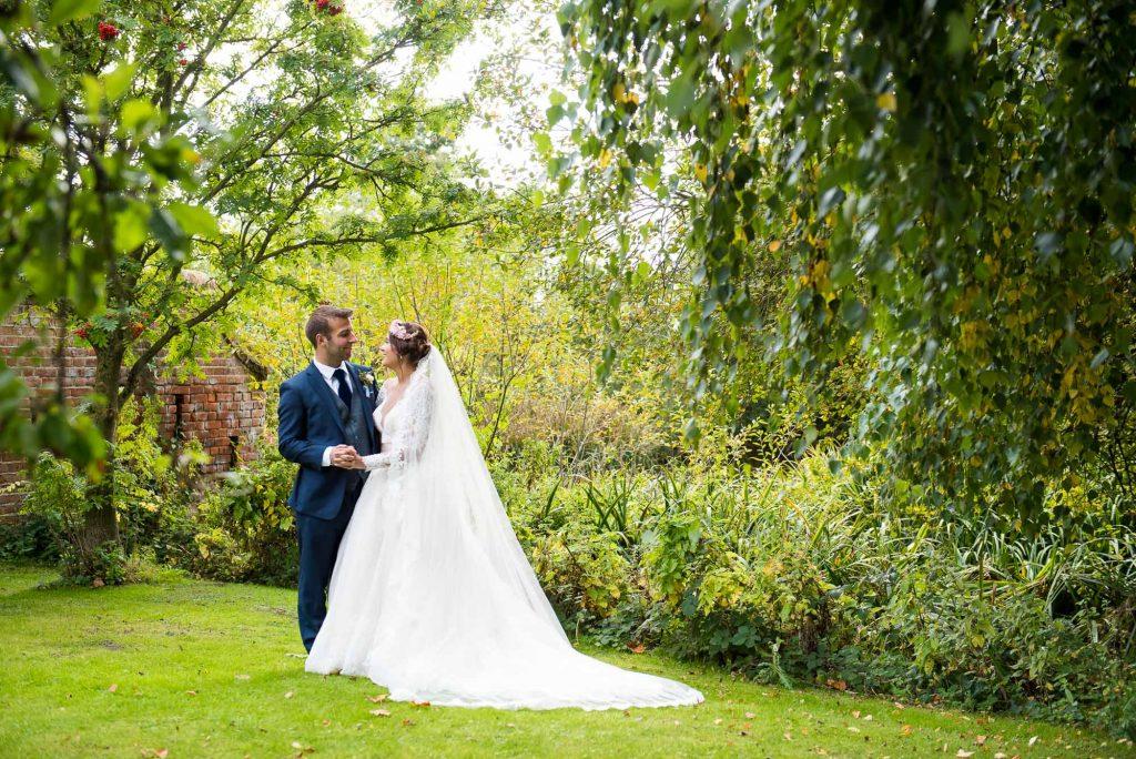 Jay West Bride with Calvin Klein groom Norfolk Barn wedding portrait