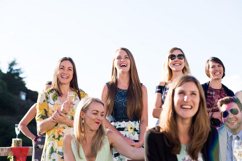 Smiling wedding guests Cornwall