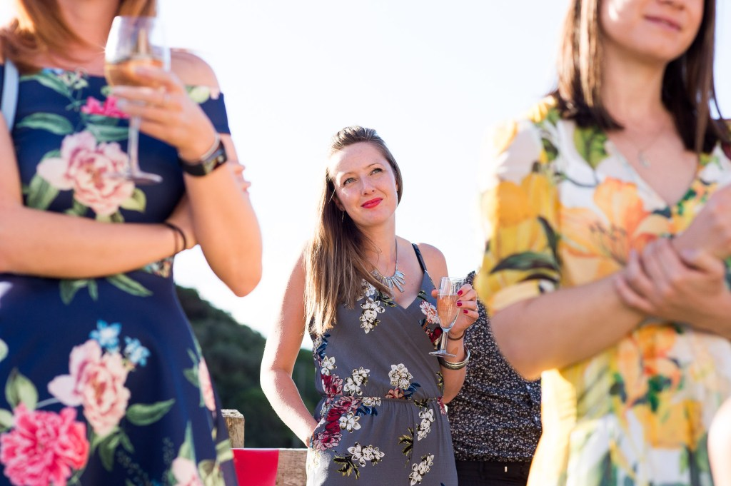Wedding guests wearing floral dresses summer outdoor Cornwall wedding