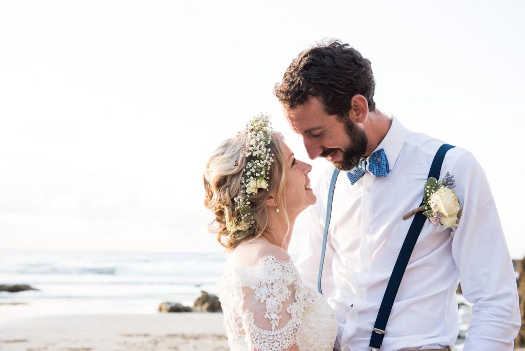 Boho bride with groom Cornwall beach wedding portrait