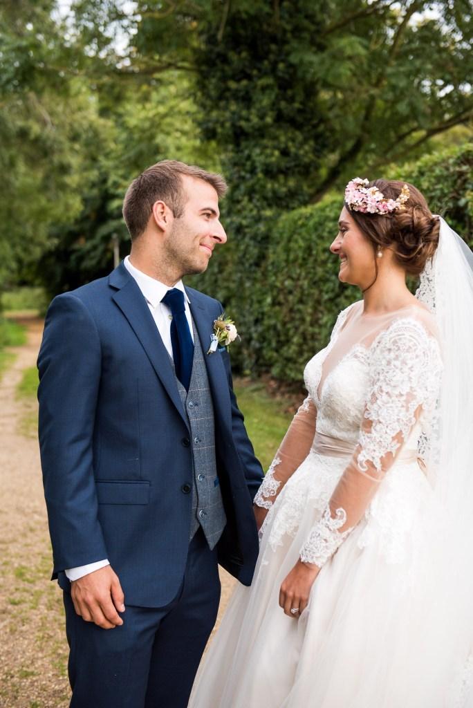 Natural wedding portrait bride wearing Jay West Bridal dress Spixworth Hall Wedding