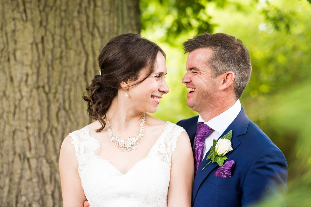 Smiling bride and groom laughing Surrey wedding