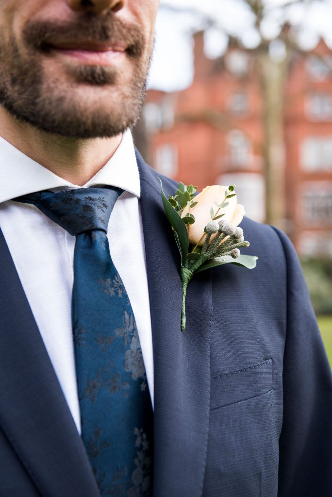 Navy blue suit with fresh white buttonhole London Wedding