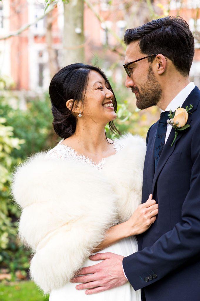 Smiling bride with groom London wedding