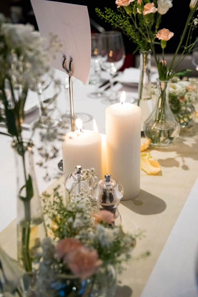White floral arrangements with candles London wedding