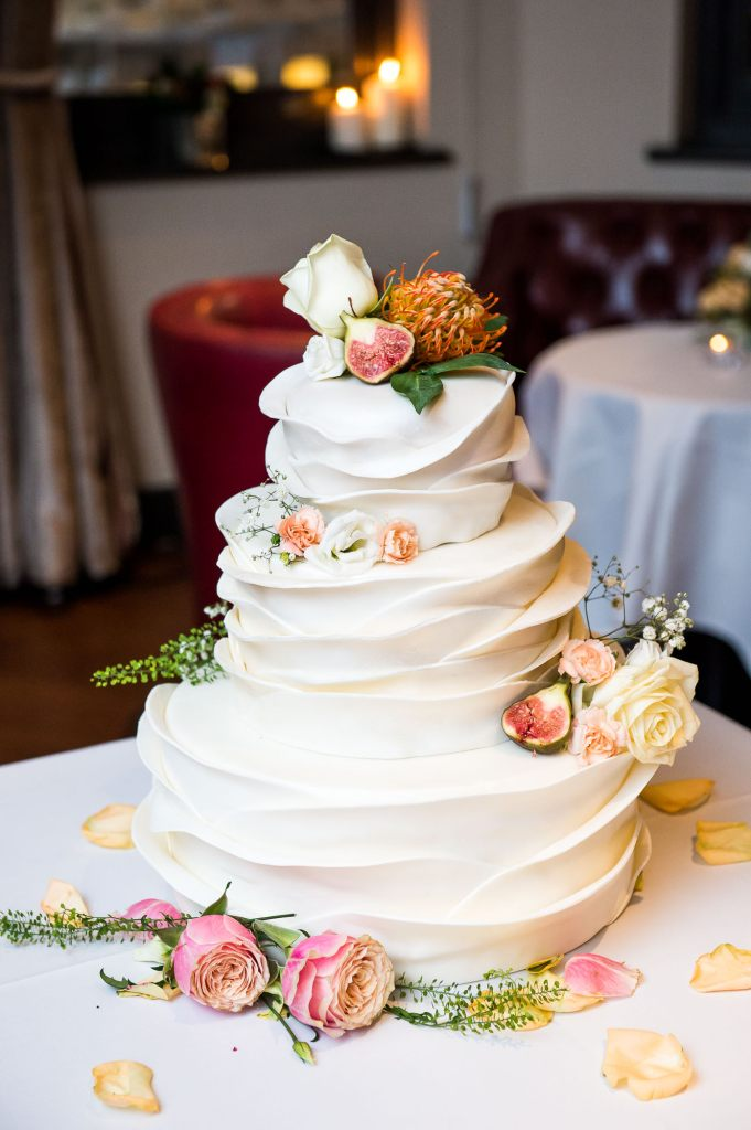 Stunning three tier white wedding cake with sugar decorations London