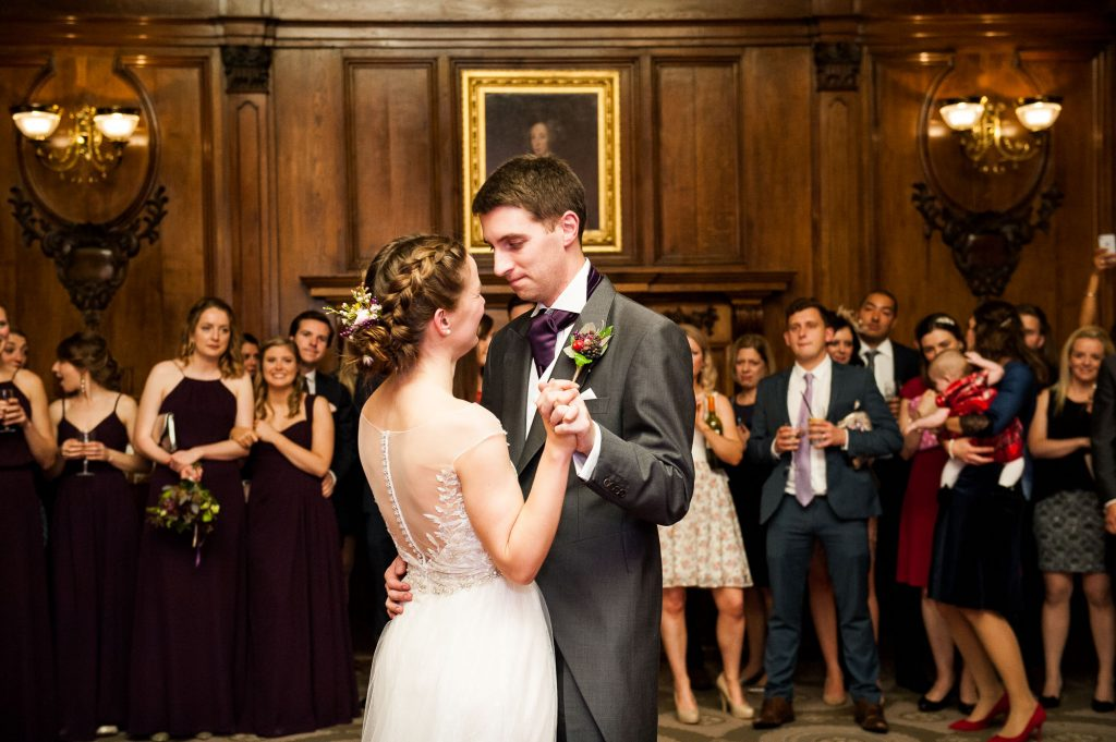 Ashridge House Wedding. Natural Wedding Photography. Couple enjoy their first dance together in the hall of Ashridge House.