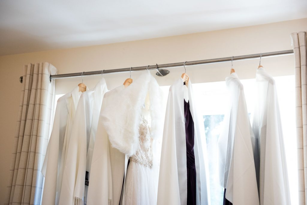 Ashridge House Wedding. Natural Wedding Photography. Bridal preparation photography dresses hanging.