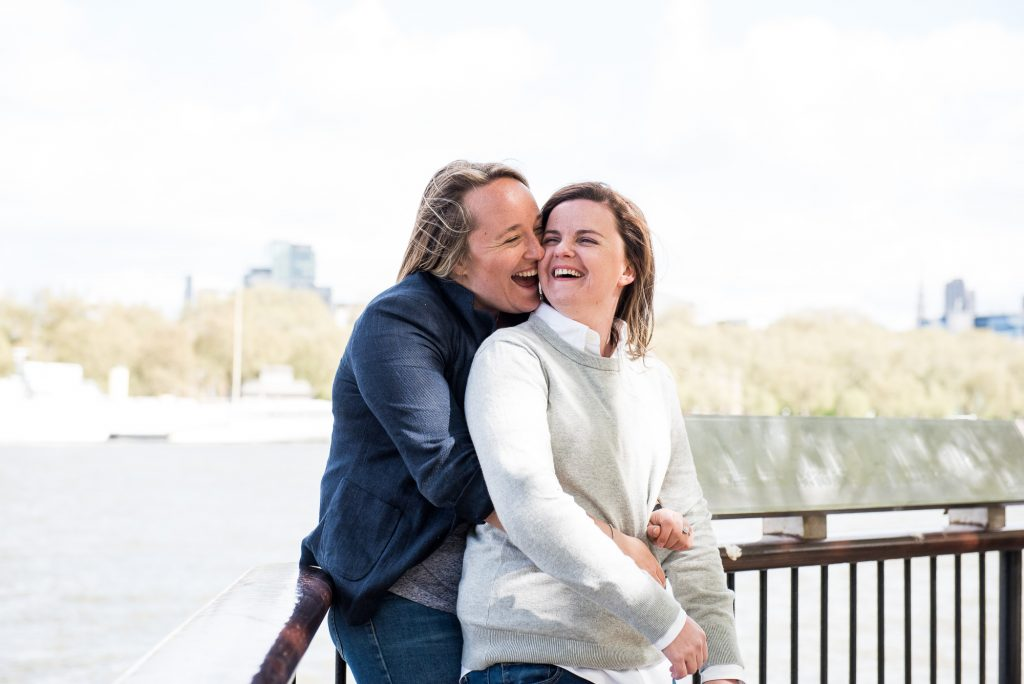 Southbank Engagement shoot, LGBT Engagement Shoot Photography, same sex couple embrace by the Thames