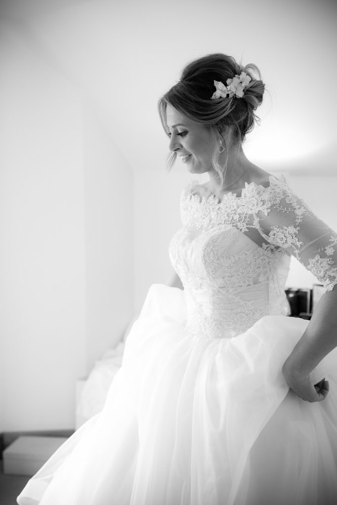 Great Fosters. Natural Wedding Photography. Candid Black and White Portrait of the Bride.