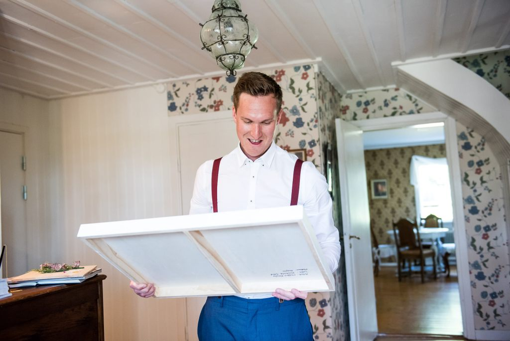 Swedish Wedding - Kroksta Gard Wedding - Groom Receiving A Surprise Present From the Bride