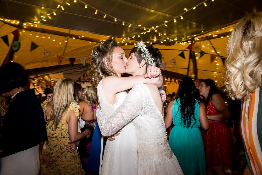 Inkersall Grange Farm Wedding - Same Sex Wedding Photography - Brides Kiss on The Dance Floor