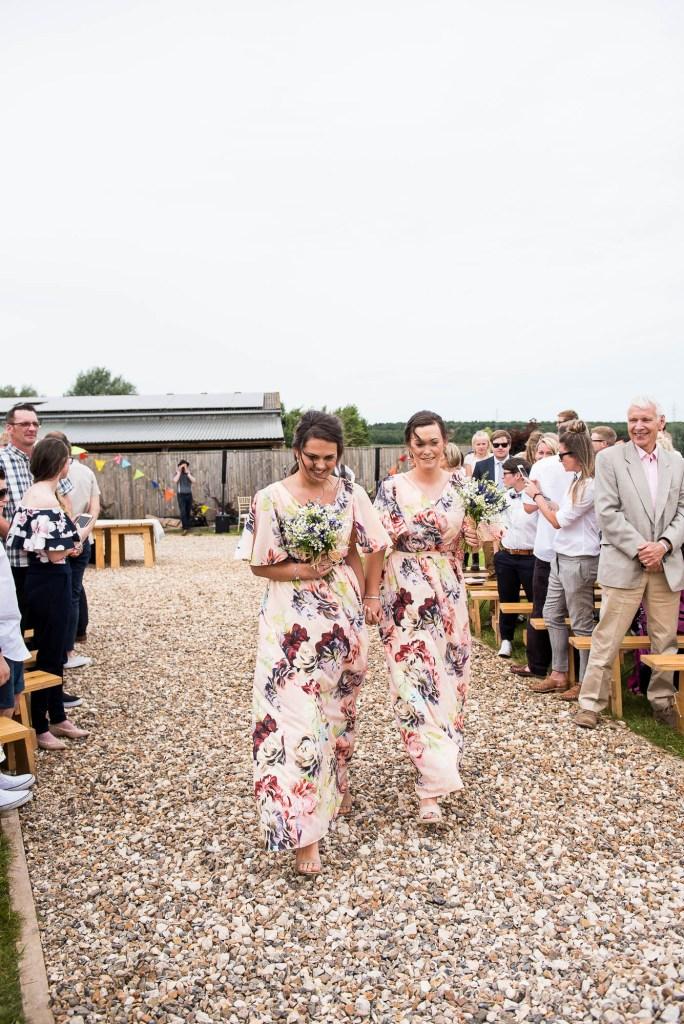 Inkersall Grange Farm Wedding - Same Sex Wedding Photography - ASOS bridesmaids walk down the aisle