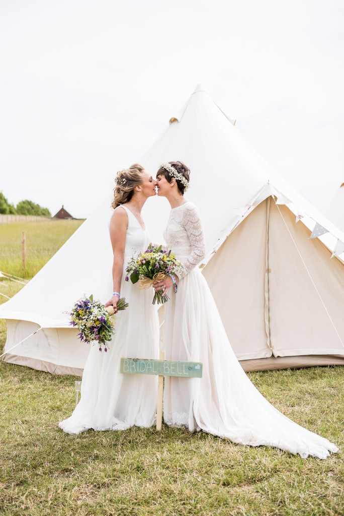 Inkersall Grange Farm Wedding - Same Sex Wedding Photography - Brides By Wedding Bell Tents Sharing a Kiss