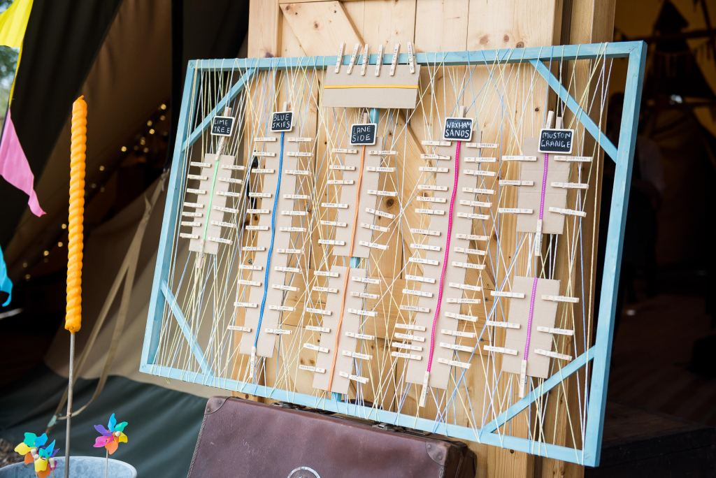 Inkersall Grange Farm Wedding - Same Sex Wedding Photography - Colourful Boho DIY Wedding Table Setting Chart With Pegs