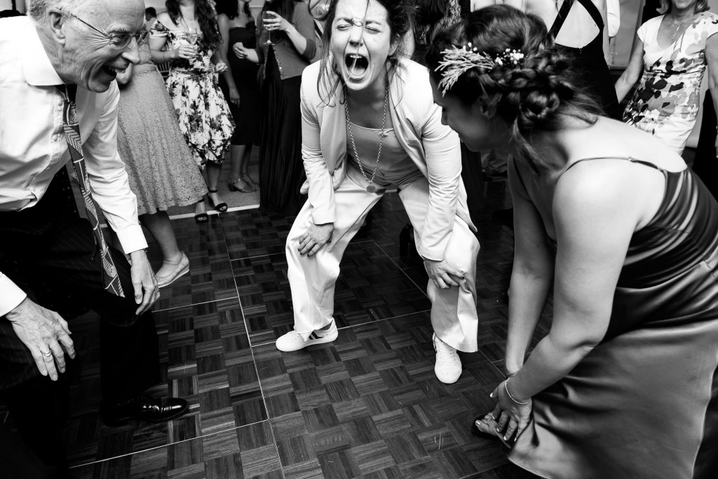 Outdoor Wedding Ceremony, Surrey Wedding Photography, Black and White Photograph Of Wedding Guest Energetically Dancing