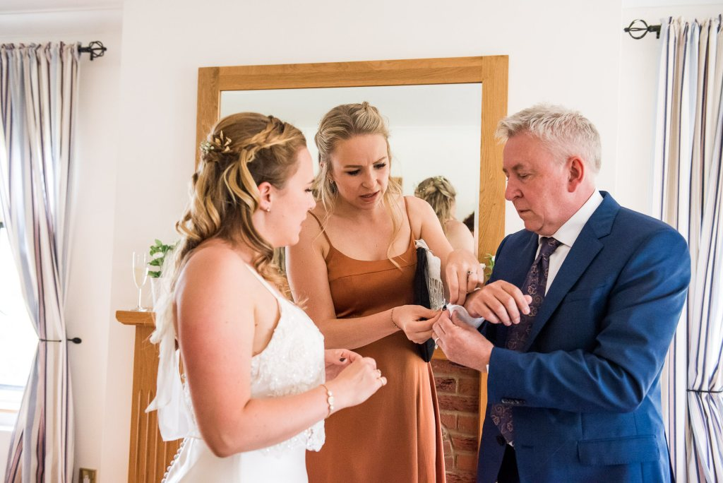 Bride and Her Sister Help Their Dad With His Cufflinks