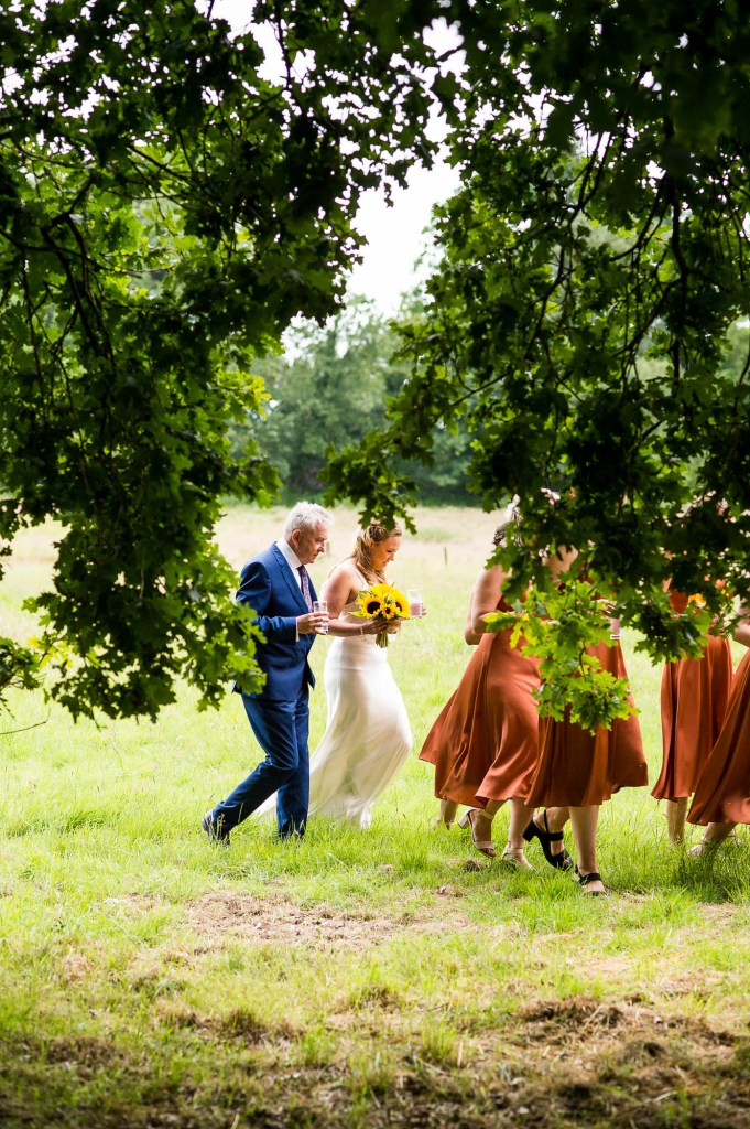 Bride Arrives To Her Outdoor Wedding With Father and Bridesmaids