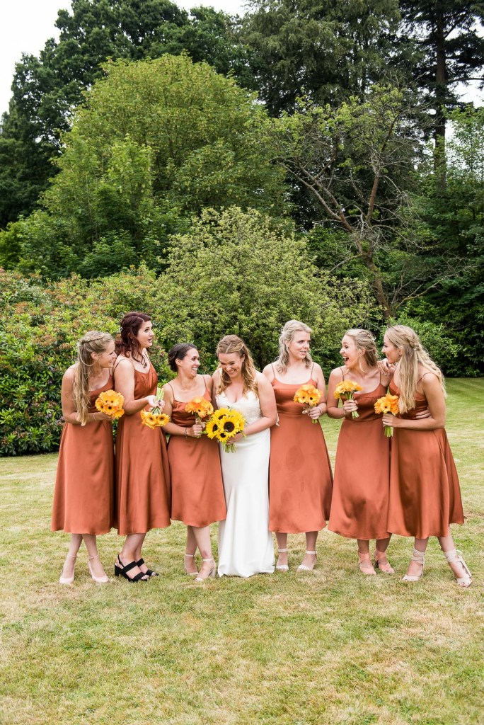 Burnt Orange Bridesmaid Dresses with Sunflower Bouquets