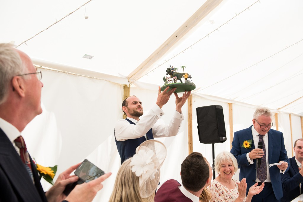 Groomsmen Holds Up The Hand Made Wedding Present