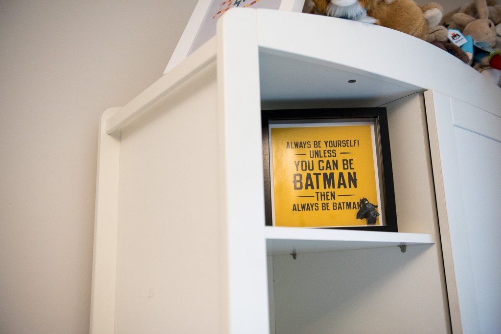 Newborn Photography Guildford, Christmas Family Shoot, Lifestyle Image of Framed Batman Photo