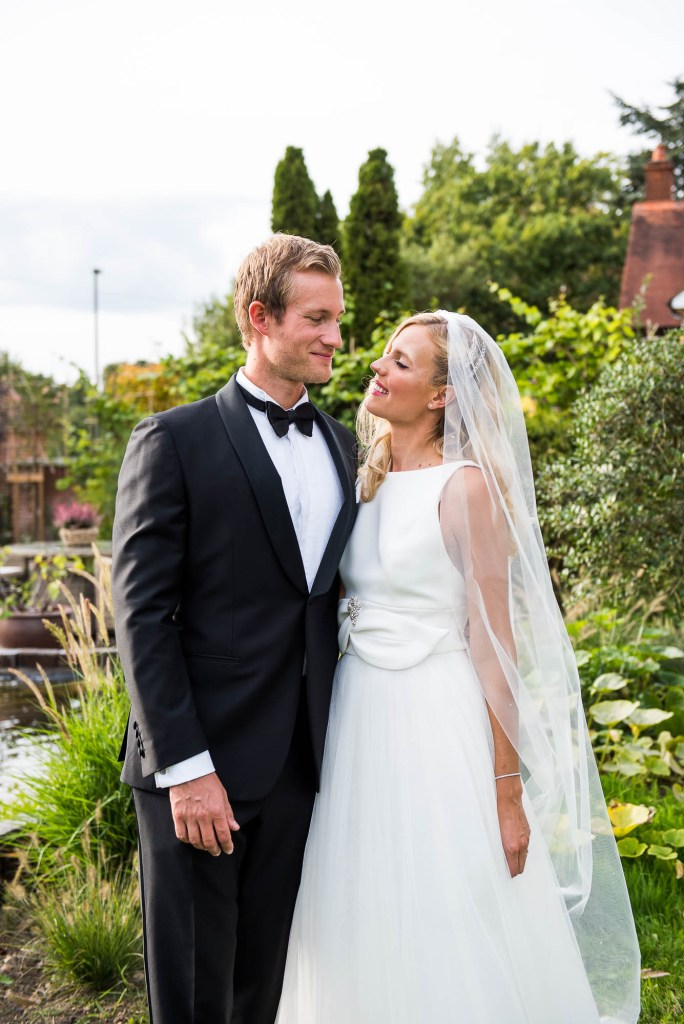 Outdoor Wedding Photography Surrey, Gorgeously Elegant Couple In Black Tie Stand For A Portrait