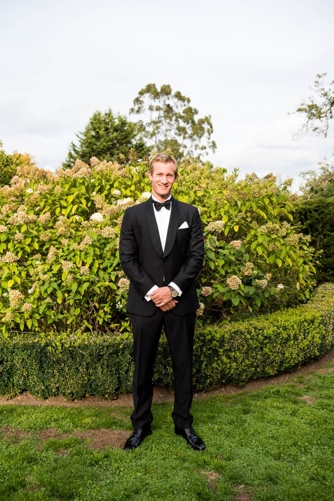 Outdoor Wedding Photography Surrey, Handsome Groom In Black Tie Dress With White Shirt and Bow Tie