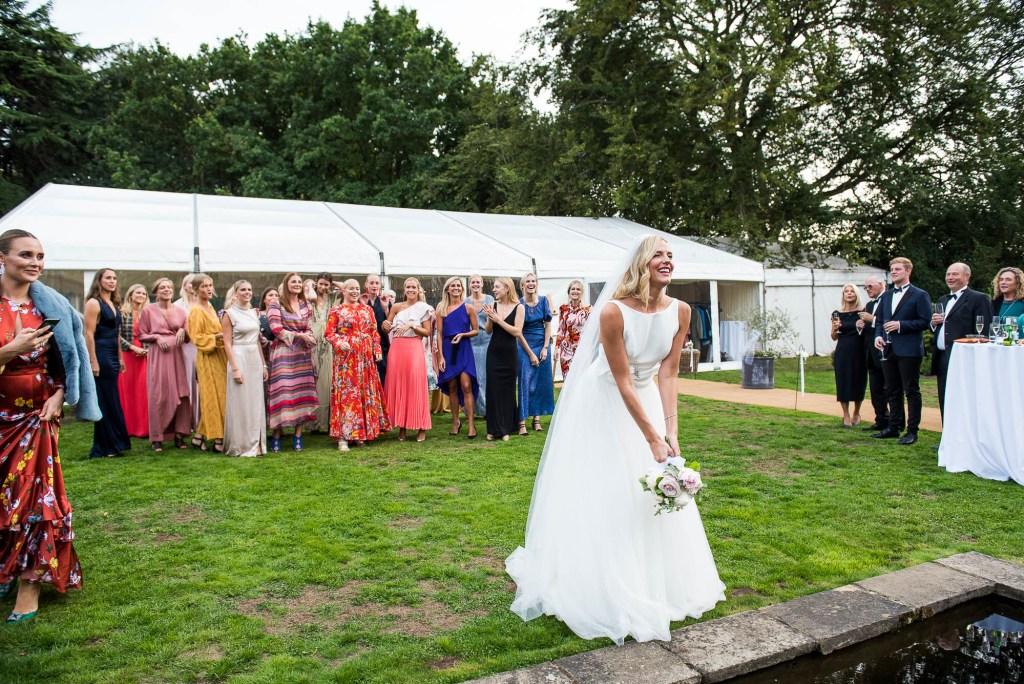 Outdoor Wedding Photography Surrey, Glamorous Bride Tosses Her Bouquet, Surrey Wedding Photography
