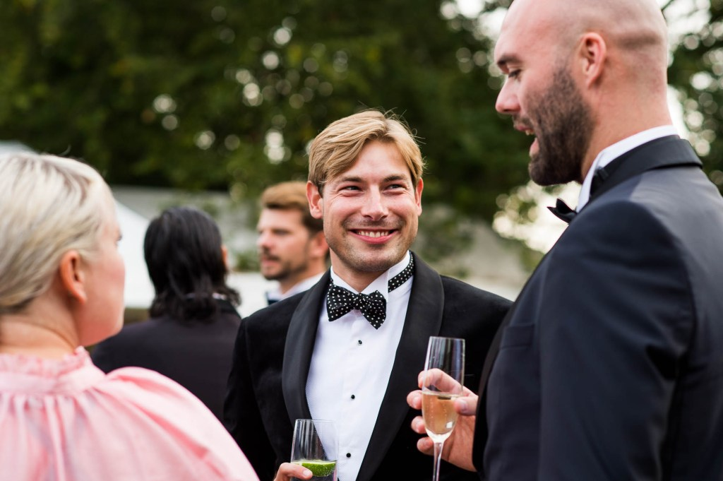 Outdoor Wedding Photography Surrey, Happy Guests Enjoy A Glamorous Black Tie Reception