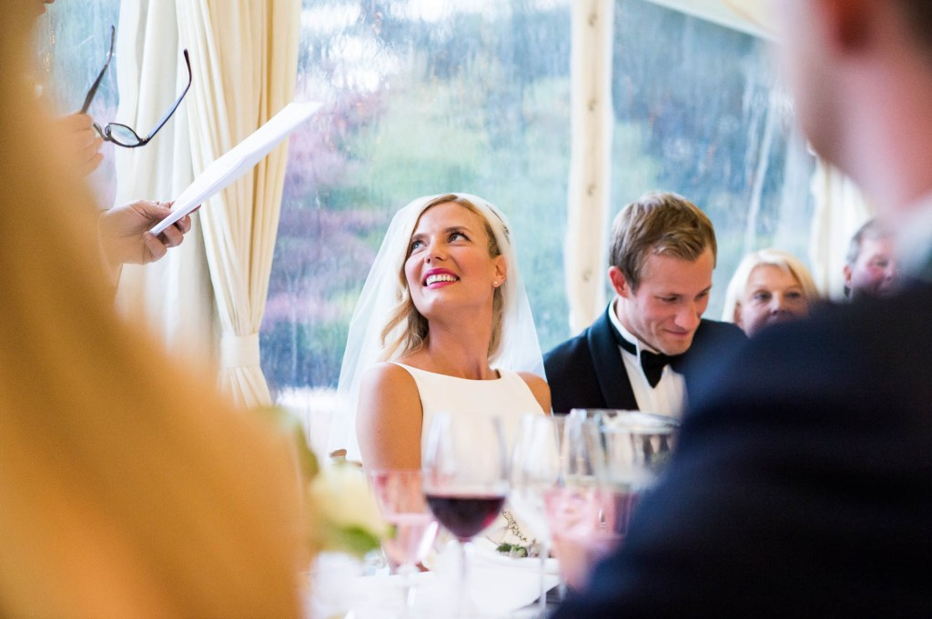 Outdoor Wedding Photography Surrey, Stunning Bride Smiling As Speeches Start