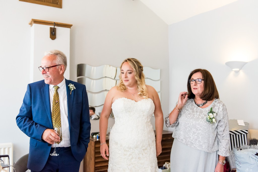 lgbt wedding photographer, Gorgeous bride in Maggie Sottero strapless lace detail wedding dress with parents