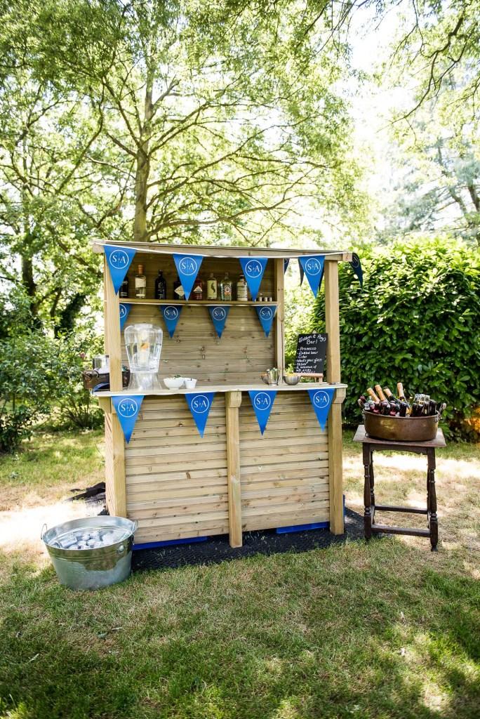 lgbt wedding photographer, bespoke bar in the garden of Dodmoor House