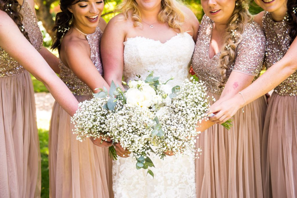 lgbt wedding photographer, beautiful bride with her bridesmaids present their white flower bouquets